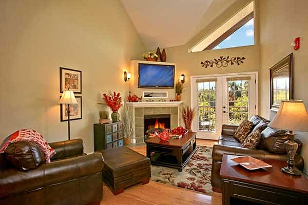 A beautiful living room with a fireplace in one of the rentals from Appleview River Resort in the Smoky Mountains.