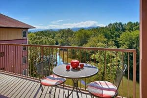 A table with two chairs overlooking the Pigeon River at Appleview River Resort in the Smoky Mountains.
