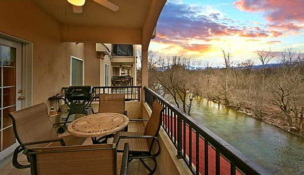 The deck of a condo overlooking the Little Pigeon River at Appleview River Resort in the Smoky Mountains.